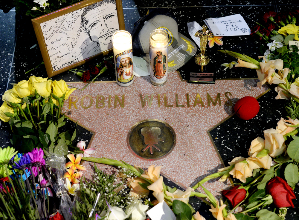 Flowers are placed in memory of actor/comedian Robin Williams on his Walk of Fame star in the Hollywood district of Los Angeles, Monday.