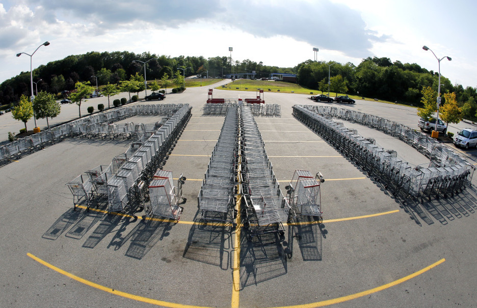 "Shopping carts are arranged to form the letters ""ATD"" in the parking lot of a Market Basket Supermarket in North Andover, Mass., on Aug. 11 in support of former CEO Arthur T. Demoulas."