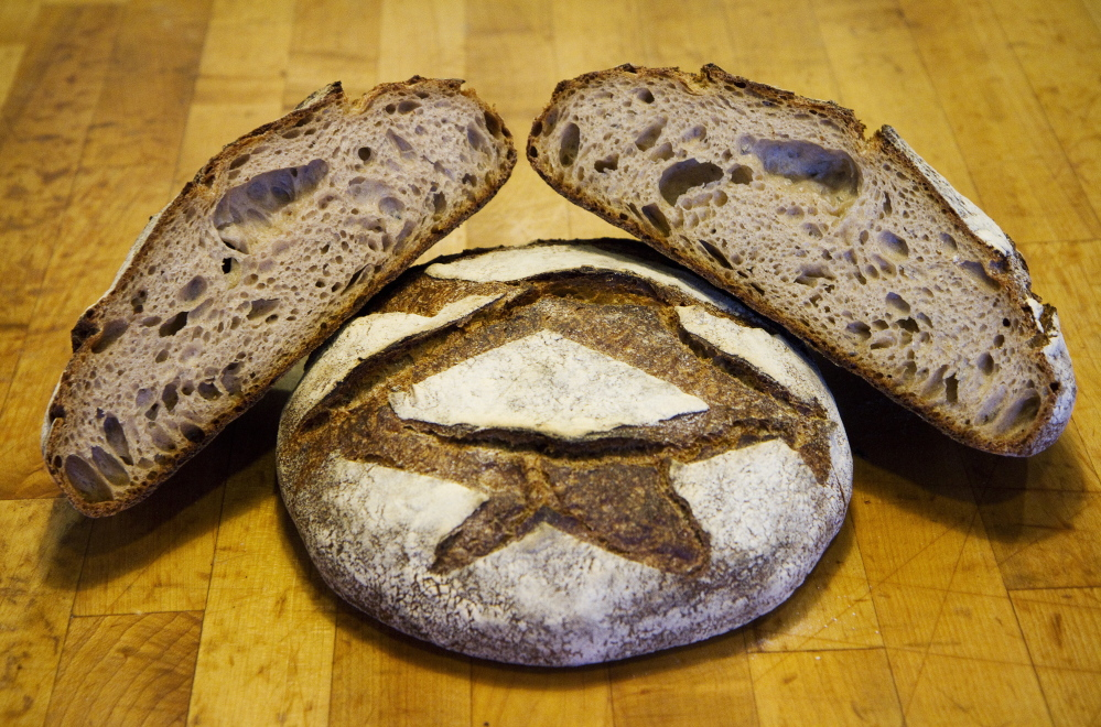 Standard Baking Co. in Portland makes its round miche bread with 100 percent Maine flour. Bakeries around the state are experimenting with using more locally grown grains in both pastries and breads, which often requires changing their baking methods.