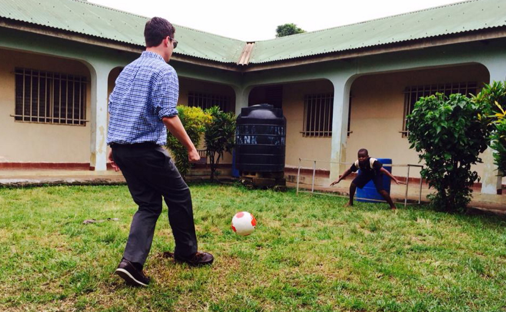 Gradi Schutt plays soccer with a child in Sierra Leone this summer. He hopes to return once the Ebola outbreak has passed.