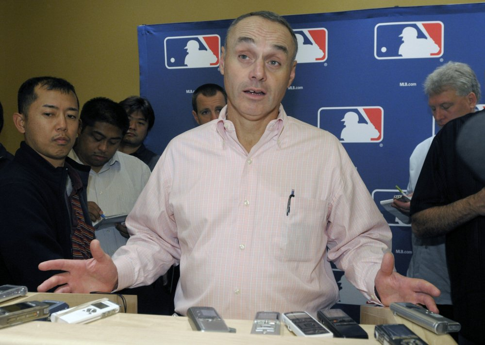 Rob Manfred, Major League Baseball's executive vice president for labor relations, will succeed Bud Selig in January as baseball commissioner.
