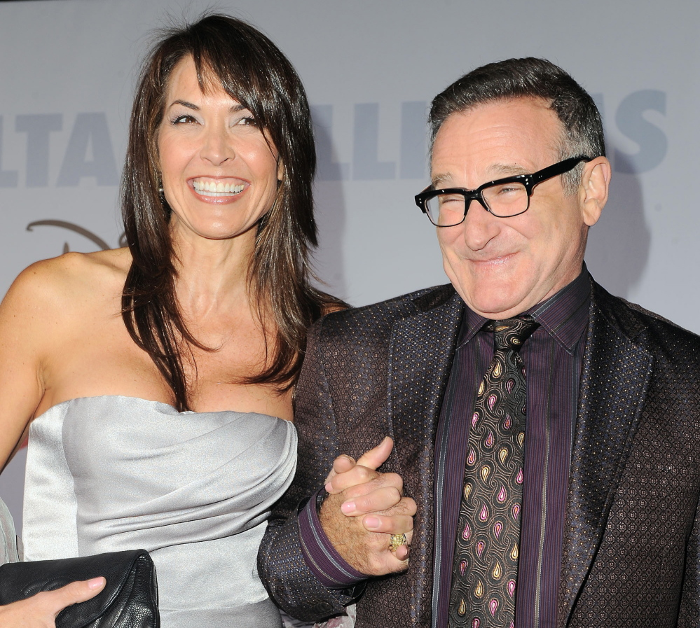 Robin Williams is shown with his wife, Susan Schneider, who said Thursday that the actor suffered from Parkinson's disease.