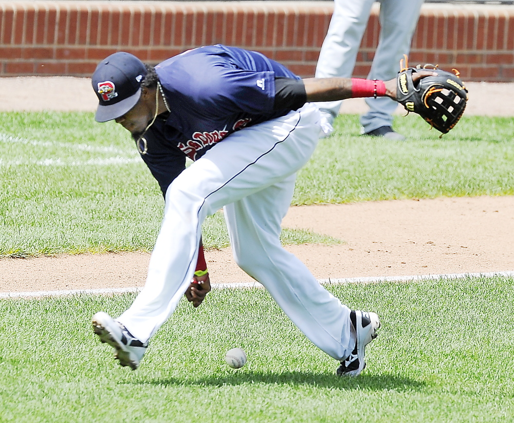 Third baseman Michael Almanzar of the Portland Sea Dogs attempts to barehand a grounder that went for a single Thursday during the first game of a doubleheader loss to the Akron RubberDucks at Hadlock Field. Portland was swept in the three-game series at home.