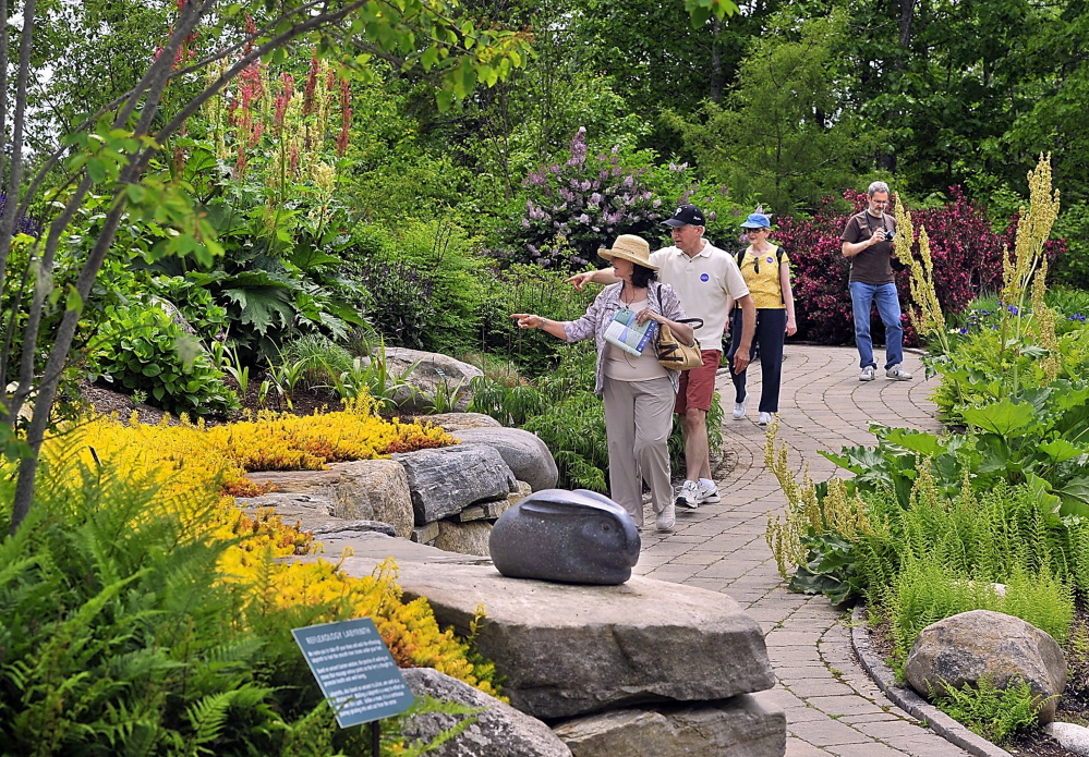 Visitors explore Coastal Maine Botanical Gardens in Boothbay.