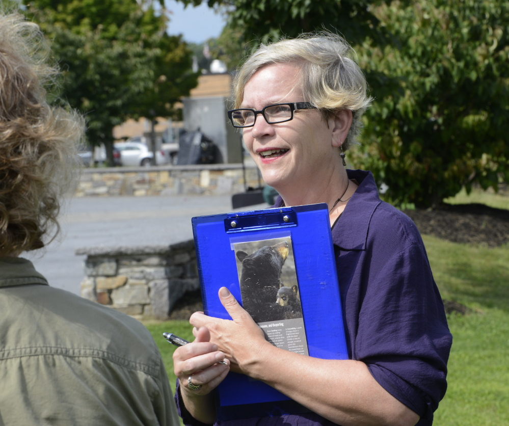 Annie Wadleigh talks with city officials about beefing up the bee-friendly plantings along the Bayside Trail.