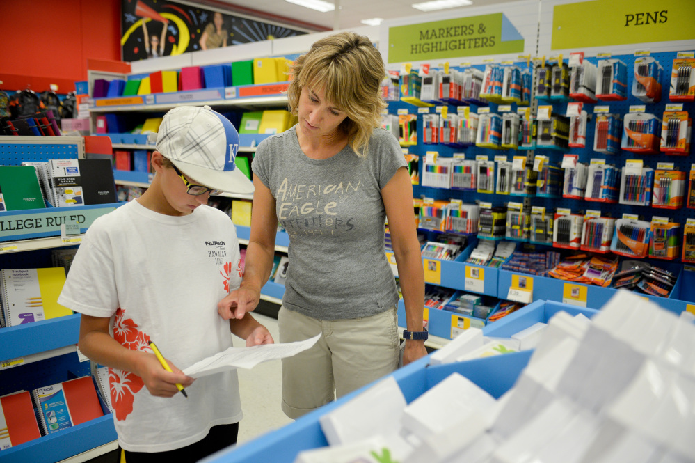 Jill Courtney shops for back-to-school supplies for her sons Will, left, and Reid, not seen, at a Target store in St. Joseph, Mo., late last month.