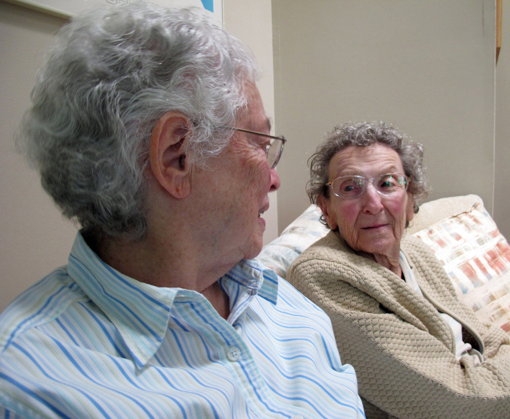 Pearl Berlin, right, listens as her spouse, Lennie Gerber, talks about a federal lawsuit, at their home in High Point, N.C. Their suit is one of four challenging the state's constitutional ban on gay marriage.