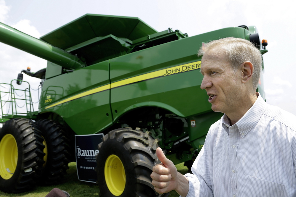 Republican candidate for governor Bruce Rauner talks to central Illinois farmers in Lincoln, Ill.