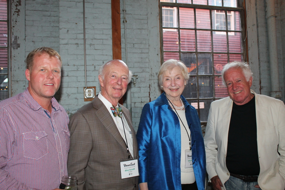 Justin Blake, grandson of Down East founder Duane Doolittle, with Allen Fernald, chairman of Down East, and his wife, Sally, and Cobb Blake, Doolittle's stepson.