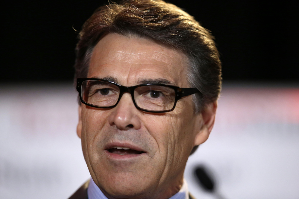 Texas Gov. Rick Perry was indicted on a charge of abusing his power after carrying out a threat to veto funding for state public corruption prosecutors.