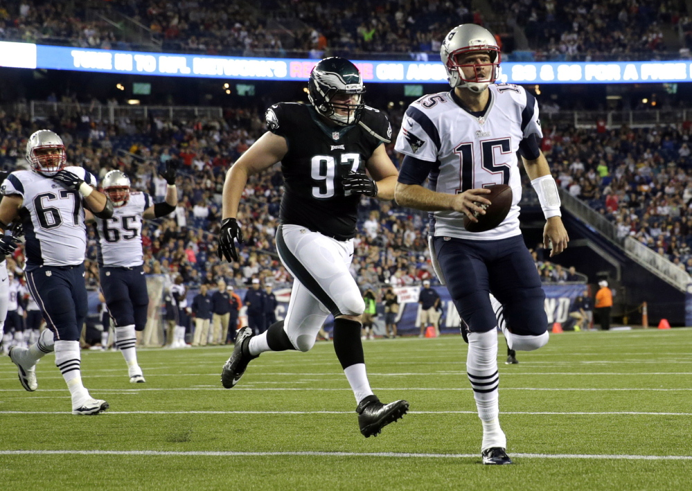 Ryan Mallett runs into the end zone ahead of Eagles defensive end Taylor Hart to scores a second-half touchdown Friday night. Mallett also threw a touchdown pass and finished 7 of 11 for 92 yards.