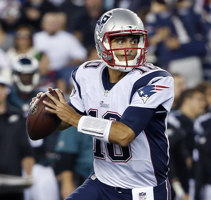 Rookie quarterback Jimmy Garoppolo looks for a receiver Friday night during the Patriots' 42-35 preseason victory against the Philadelphia Eagles at Gillette Stadium. Garoppolo threw two touchdown passes in the first half as he continued his battle with Ryan Mallett for the No. 2 quarterback job.