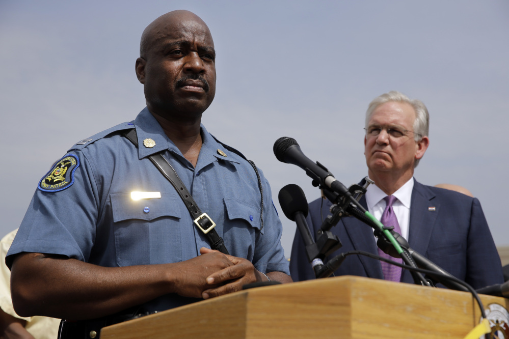 Capt. Ron Johnson of the Missouri Highway Patrol, left, and Missouri Gov. Jay Nixon take part in a news conference Friday in Ferguson, Mo. Nixon assigned protest oversight to Johnson after violent protests in Ferguson erupted in the wake of the fatal shooting of  Michael Brown by a police officer on Aug. 9.