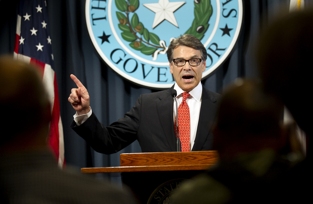 Gov. Rick Perry makes a statement in Austin, Texas, on Saturday concerning his indictment on charges of coercion of a public servant and abuse of his official capacity. Perry is the first Texas governor since 1917 to be indicted. The Associated Press