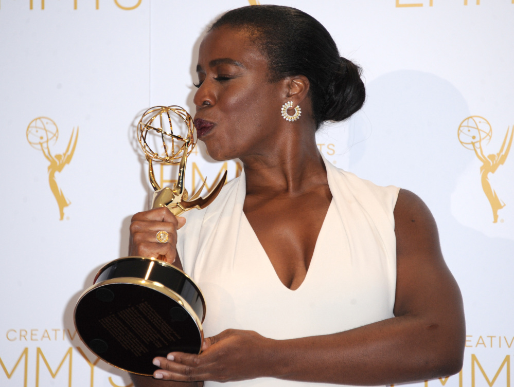 "Uzo Aduba kisses her Emmy for her role in ""Orange is the New Black"" in Los Angeles on Saturday."