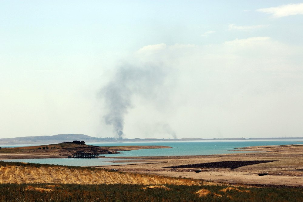 Smoke rises during airstrikes targeting Islamic State militants at the Mosul Dam outside Mosul, Iraq, Monday.