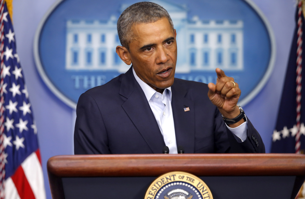 President Obama answers a reporter's question Monday at the White House, where he met with top advisers to review developments in Iraq and in Ferguson, Missouri.