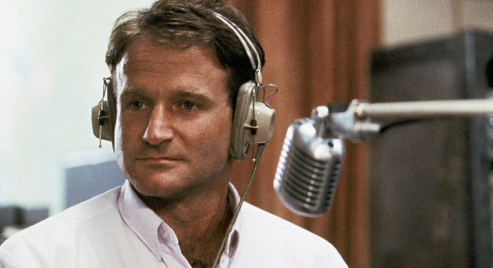 "Robin Williams is shown in character as real-life disc jockey Adrian Cronauer in ""Good Morning, Vietnam."" He made us look at ourselves in ways that challenged and shocked us."