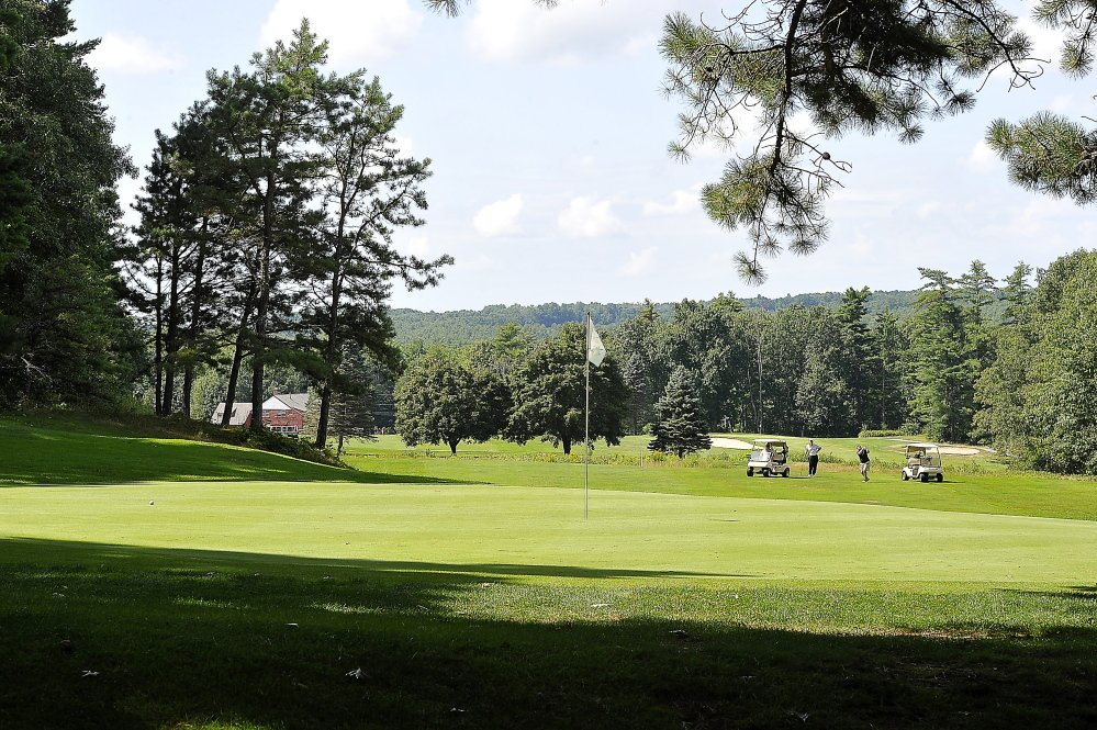 Golfers hit their approach on the 11th hole at the Sanford Country Club recently. Baseball Hall of Famer Ted Williams would play a round from time to time at Sanford, which expanded from nine to 18 holes in 1996. Ricky Jones won the Maine Amateur there in 2004.
