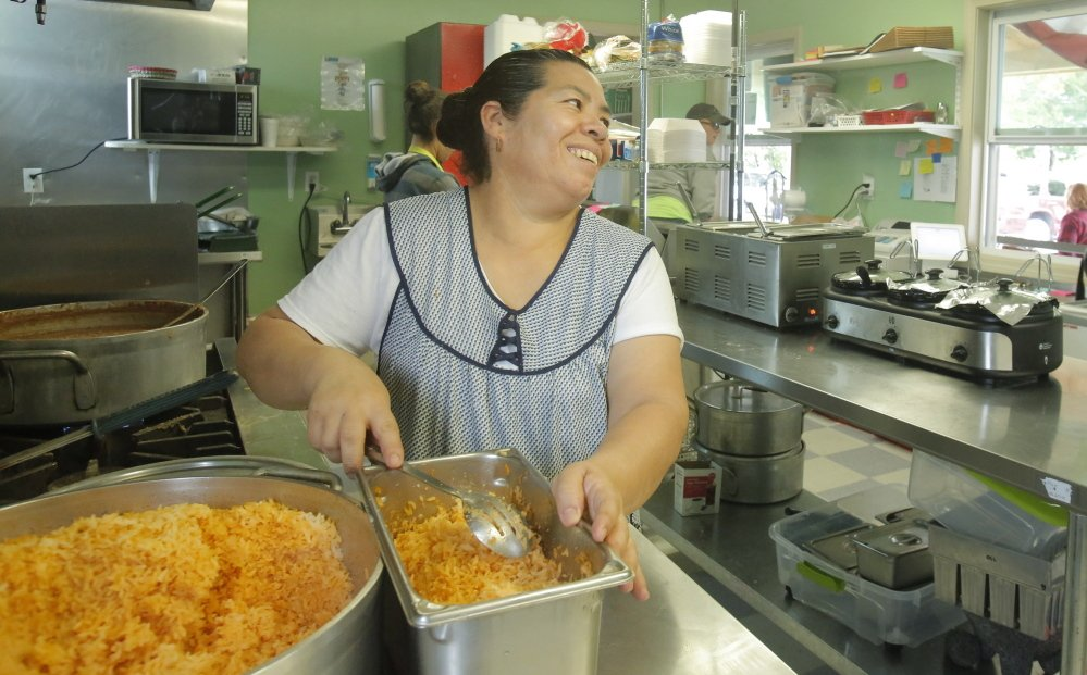 Ramona Vazquez divvies up a batch of yellow rice, a customer favorite, at Vasquez Mexican Takeout on Main Street in Milbridge.