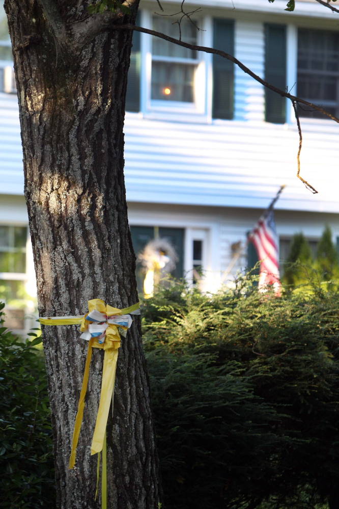 A ribbon is tied to a tree outside the home of American freelance journalist James Foley on Tuesday in Rochester, N.H.