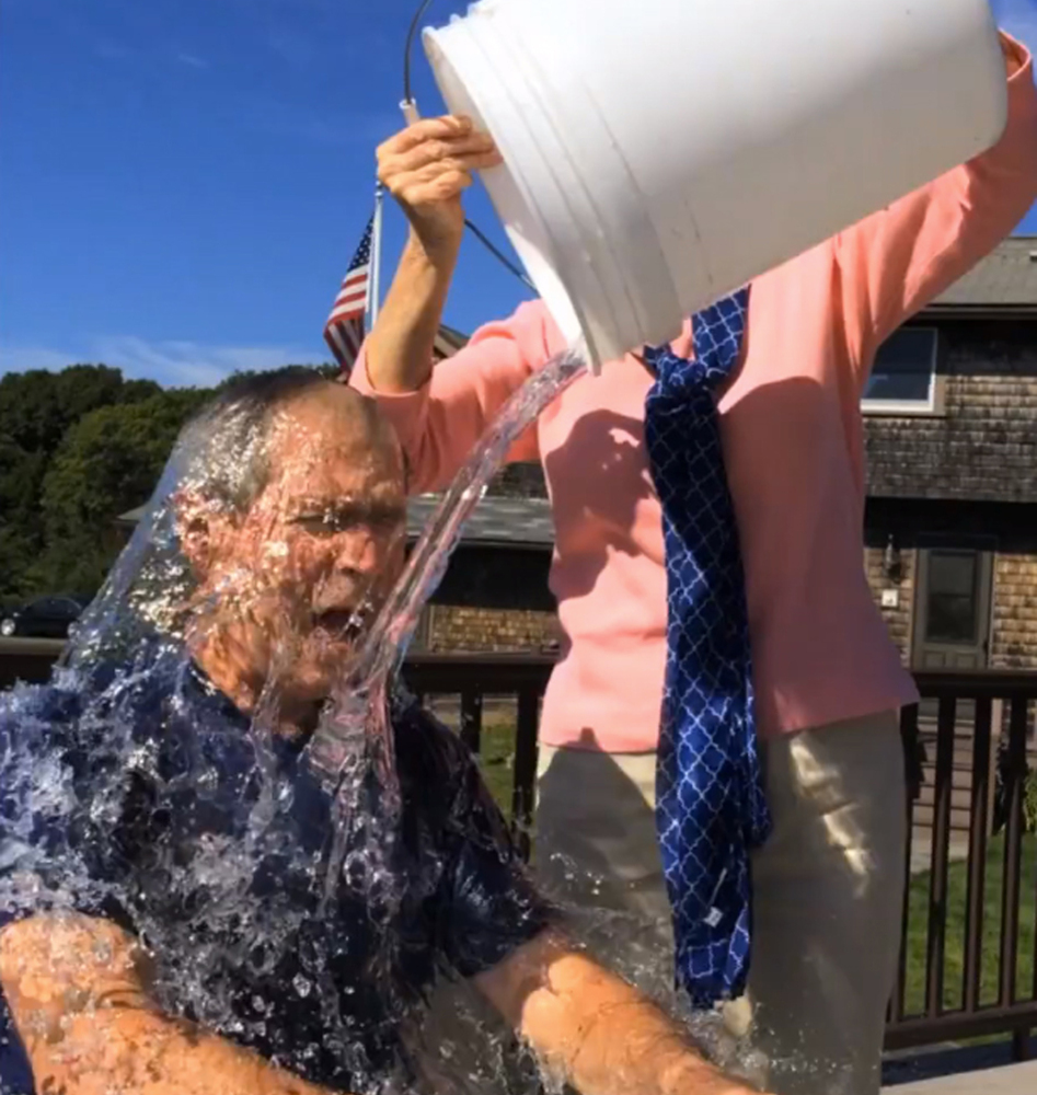 Former President George W. Bush participates in the ice bucket challenge with the help of his wife, Laura Bush, in Kennebunkport.