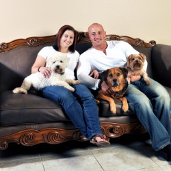 """Kris Rotonda, who founded YouMustLoveDogsDating.com, with his girlfriend Denise Fernandez and three of his four dogs, Kobe, a bichon frise, Jordan, a bull mastiff German shepherd and Samoyed mix, and Coco, a Yorkie in Clearwater, Fla. """"Dogs on first dates are amazing icebreakers,"""" said Rotonda, who started up the site last year that now has 2 million members. """"You find out right off the bat how everyone in a relationship will fit in."""""""
