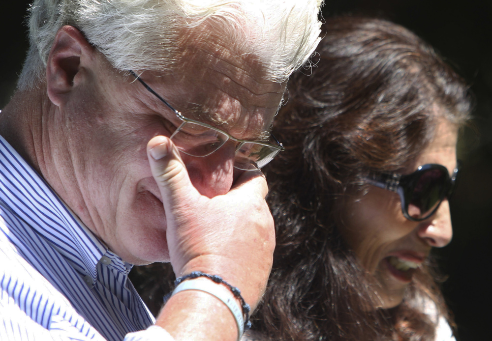 After speaking with U.S. President Barack Obama by phone, John and Diane Foley, the parents of slain journalist James Foley, talk to reporters Wednesday outside their home in Rochester, N.H. The United States tried to rescue hostages, including Foley, but the attempt was not successful.