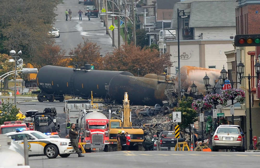 DOT-111 crude oil tank cars are seen in downtown Lac-Megantic, Quebec, on July 9, 2013, three days after a runaway train exploded, killing 47 people. Canada has banned 5,000 of the most decrepit DOT-111 cars, but the U.S. is calling for a much more drawn-out retirement process.