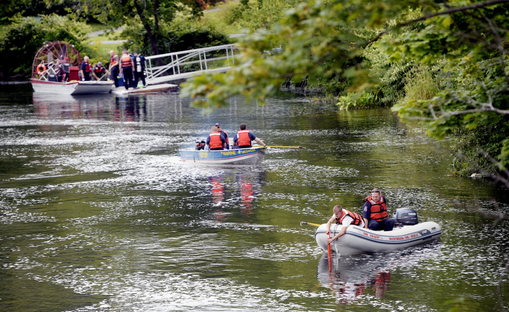 Rescue workers from about 10 agencies search the Presumpscot River in Westbrook on Thursday morning for a man believed to be in the river.