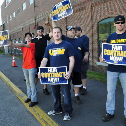 United Steelworkers Local 449 members demonstrate outside the Huhtamaki plant Wednesday in Waterville. Union member Alan Rose, right, said the workers have been without a contract for two years.