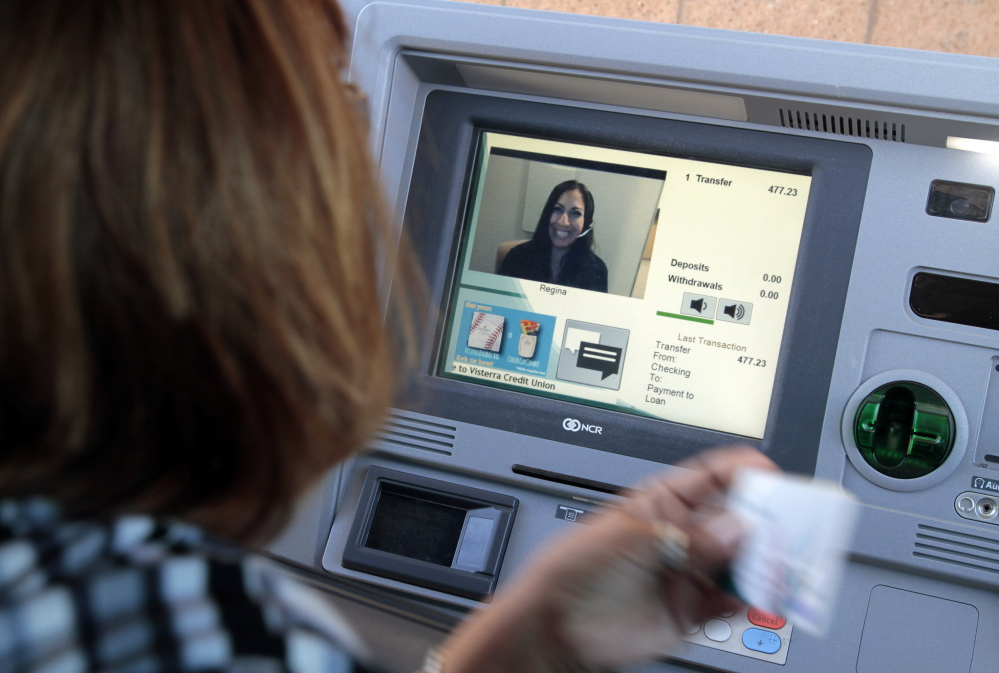 Veronica Vallejos talks to Regina as she makes a loan payment while using the drive-thru at Visterra Credit Union in Moreno Valley, Calif., where customers can video chat with a live teller – not a robot – to conduct their banking business.