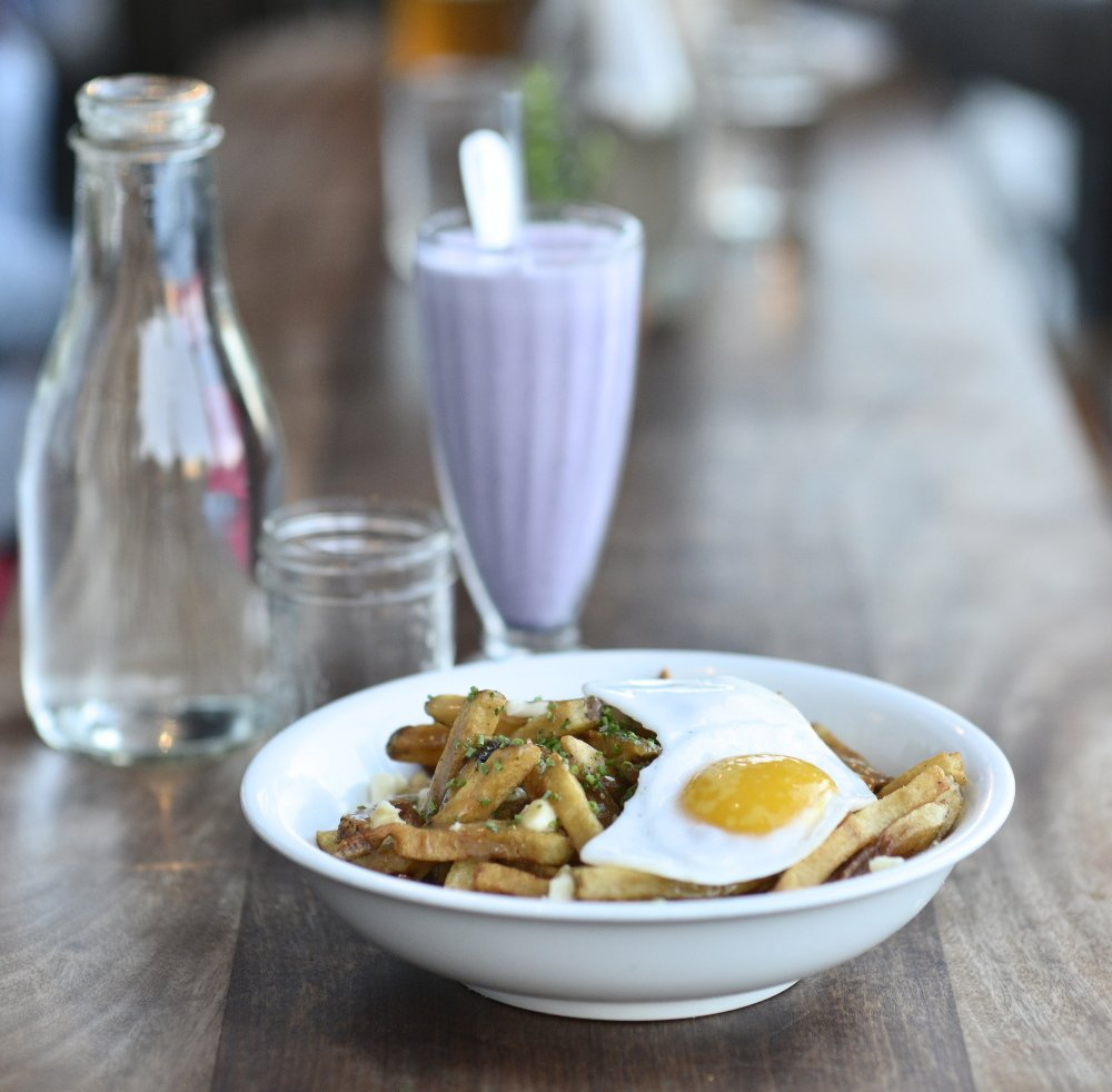 Duckfat's poutine features fries, a duck egg, duck gravy and cheese curds.