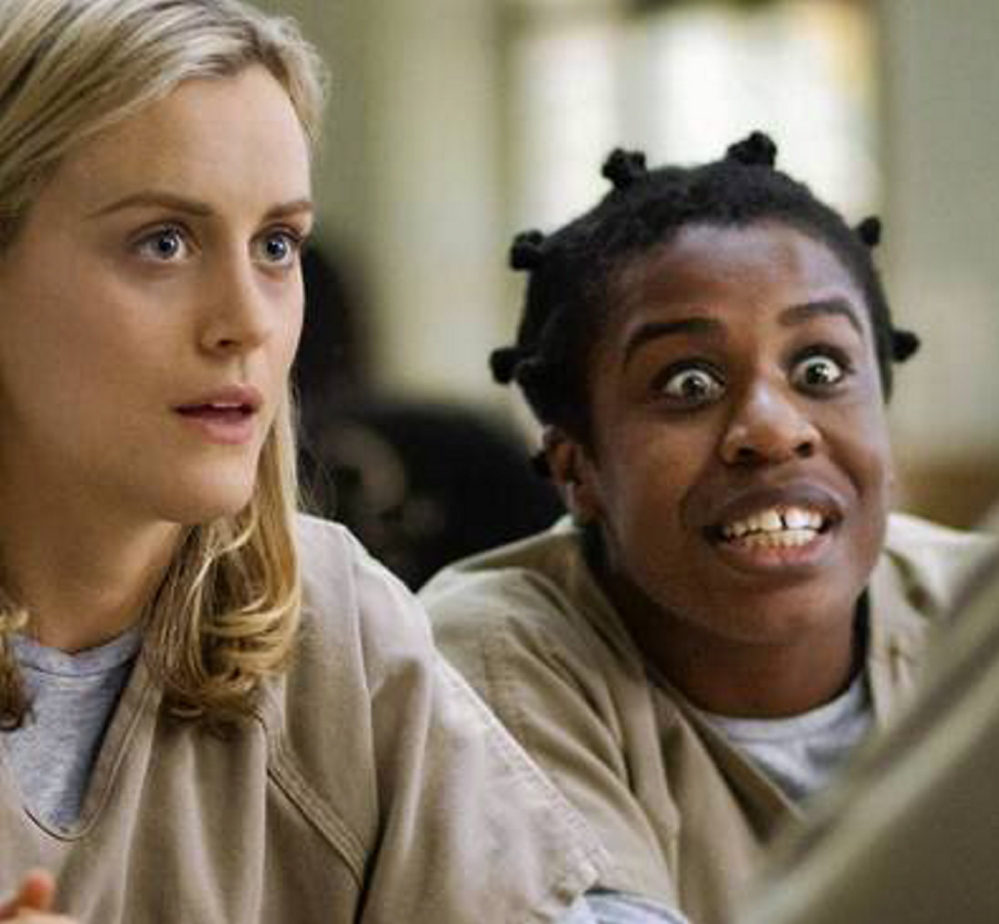 """Taylor Schilling, left, as Piper and Uzo Aduba as Crazy Eyes in the Netflix series """"Orange Is the New Black,"""" which is nominated as a comedy despite its often serious tone."""