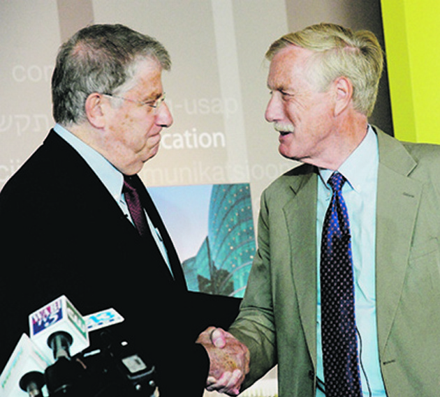 Sen. Angus King, right, shakes hands with independent candidate for governor Eliot Cutler on Monday in Portland.