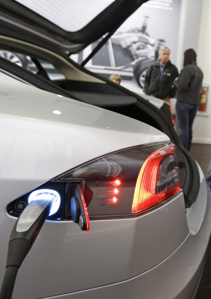 A Tesla electric car gets charged up earlier this year at a showroom in Cincinnati, Ohio.