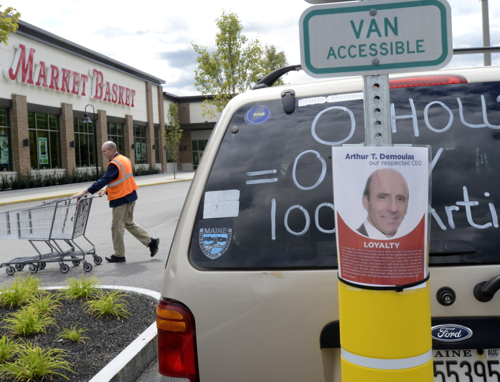 An employee at the Market Basket in Biddeford tries to stay busy Saturday while the company's board of directors met to consider the latest offer from Arthur T. Demoulas. The board has not announced any additional meetings.