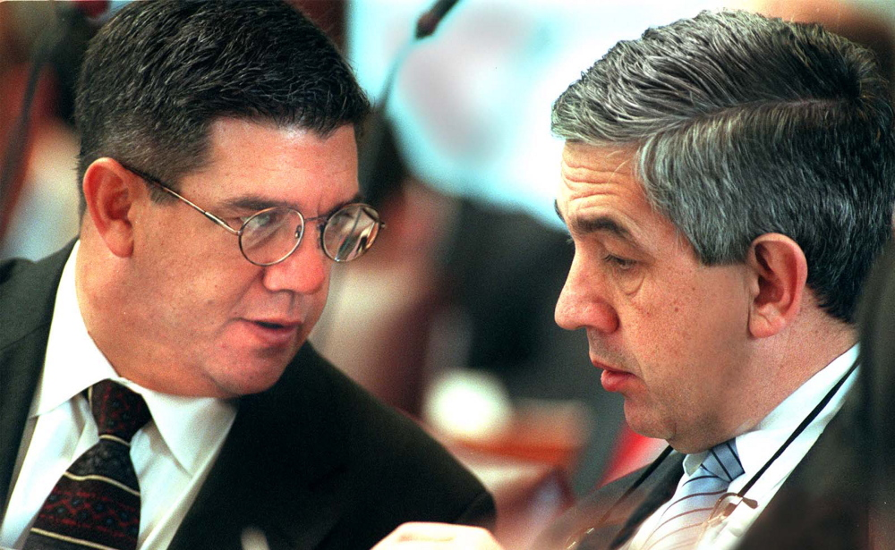 Chris and Kevin Muse confer in House chambers  in 2001. Press Herald file photo