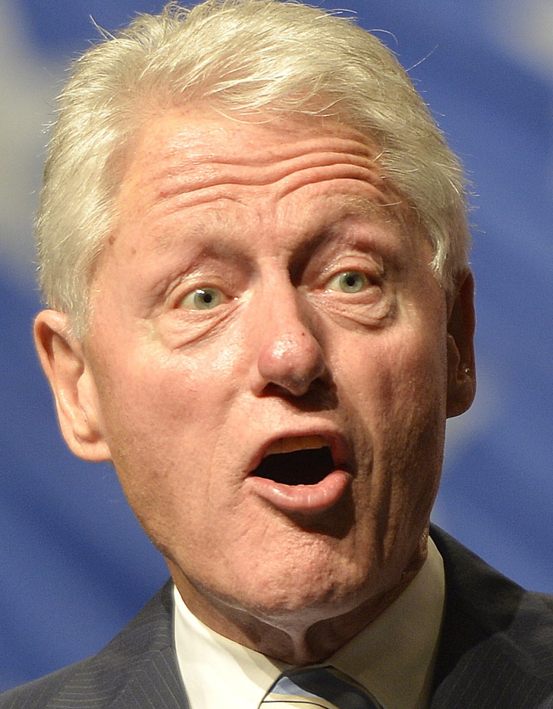 Former President Bill Clinton speaks to a group of supporters during a rally for Kentucky Democratic Senatorial candidater Alison Lundergan Grimes, Wednesday, Aug. 8, 2014, at the Hal Rogers Center in Hazard, Ky. (AP Photo/Timothy D. Easley)