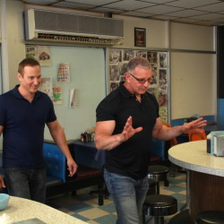 Chef Robert Irvine and designer Lynn Kegan take stock of Uncle Andy's during filming at the South Portland diner in June. The episode will have its first cable showing this Wednesday at 10 p.m.
