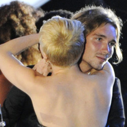 Miley Cyrus hugs Jesse Helt, a homeless 22-year-old, at the MTV Video Music Awards at The Forum in Inglewood, Calif. on Sunday.