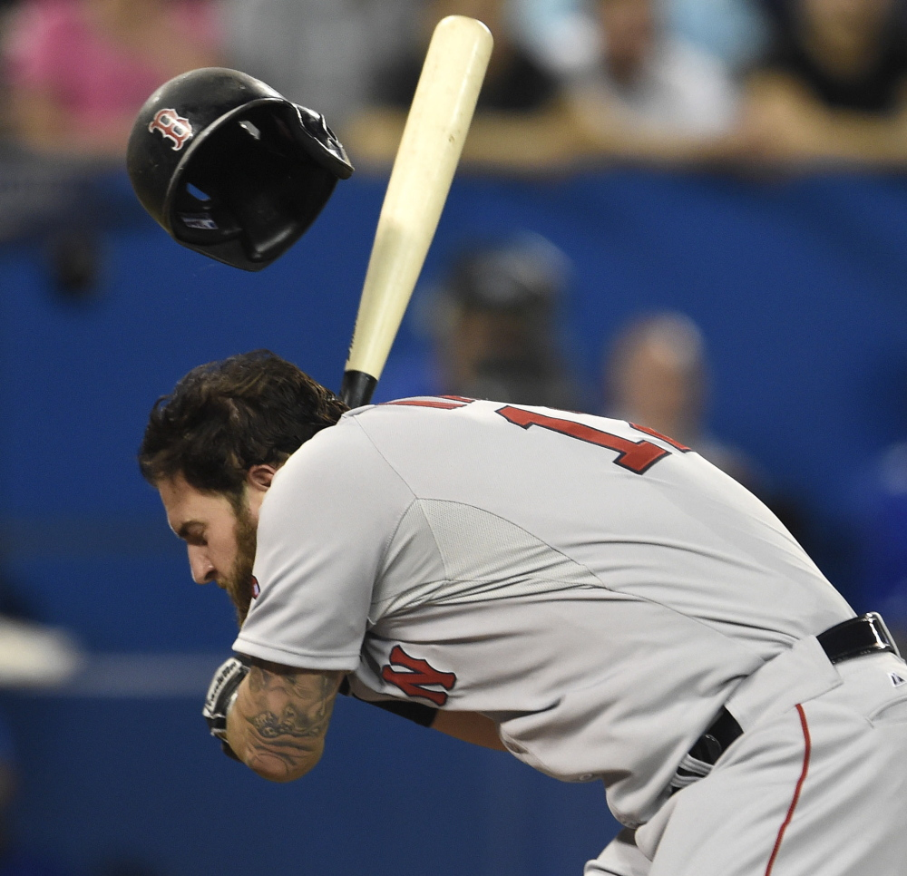 Mike Napoli of the Boston Red Sox is hit by a pitch Tuesday night during the fifth inning of an 11-7 victory against the Toronto Blue Jays in 11 innings. Napoli stayed in the game.