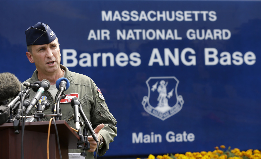 U.S. Air National Guard Col. James Keefe, commander of the 104th Fighter Wing, takes questions from reporters in front of Barnes Air National Guard Base, in Westfield, Mass., on Wednesday about a crashed Massachusetts Air National Guard F-15C fighter.