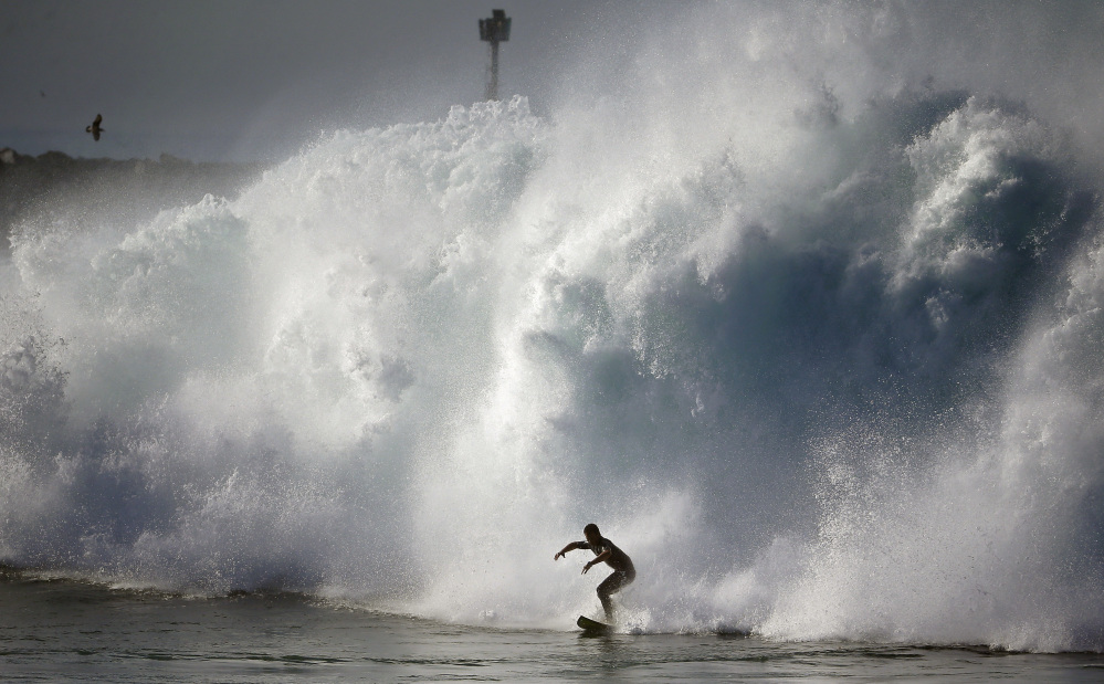A surfer rides a wave Wednesday at the notorious Wedge in Newport Beach, Calif. Hurricane Marie off the coast of Mexico spawned life-threatening water conditions.