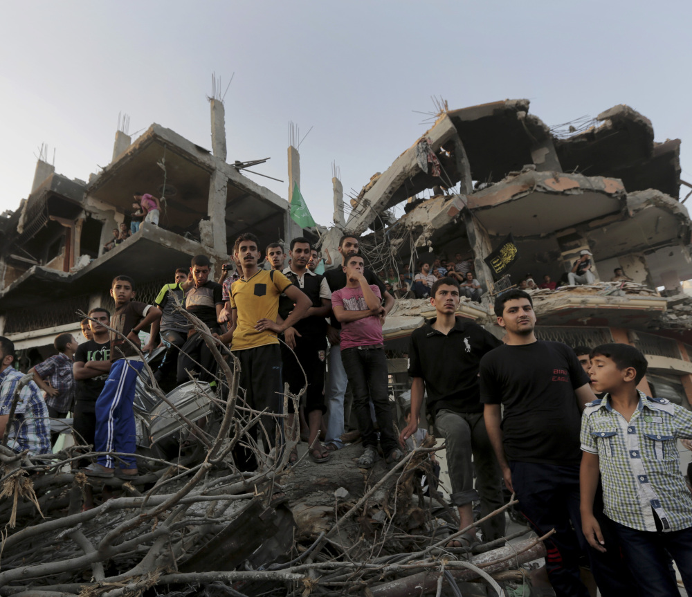Palestinians attend a victory rally organized by Hamas at the debris of destroyed houses in Shijaiyah, a neighborhood in Gaza City, on Wednesday.