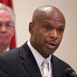 Former St. Louis police chief Daniel Isom II speaks after being named director of the Missouri Department of Public Safety at a news conference Wednesday with Gov. Jay Nixon, left.