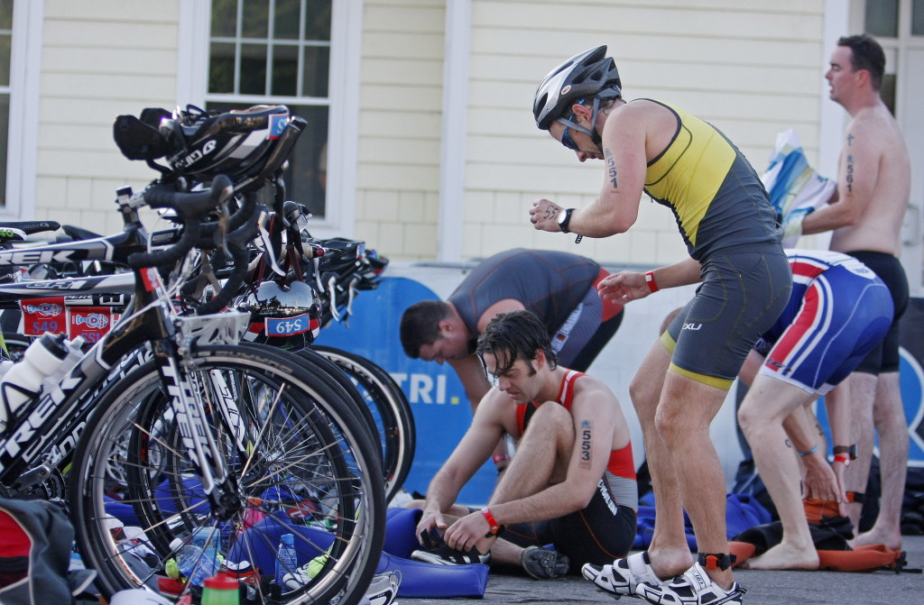 Competitors transition from the swimming portion of the event to the bike portion. There was an Olympic distance triathlon, a half Ironman, a SheJams race, and aquabike races in each category.