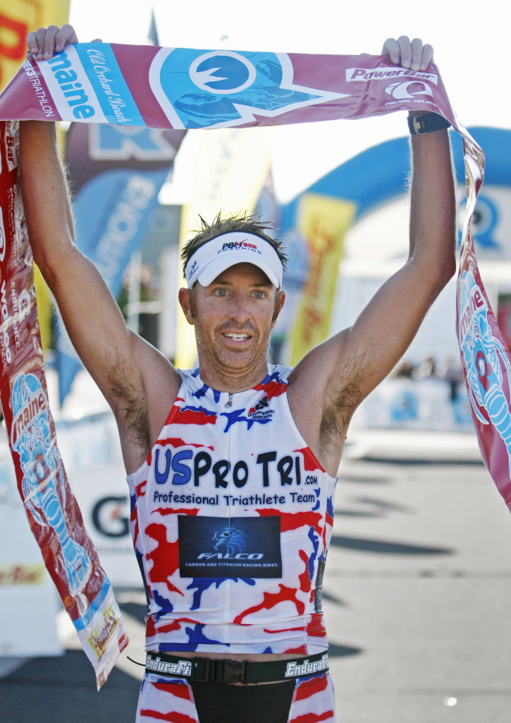 Mike Caiazzo of Falmouth celebrates after winning the overall title in the Olympic distance at the Rev3 Triathlon in Old Orchard Beach. Caiazzo, 36, finished in 1 hour, 56 minutes, 23 seconds.