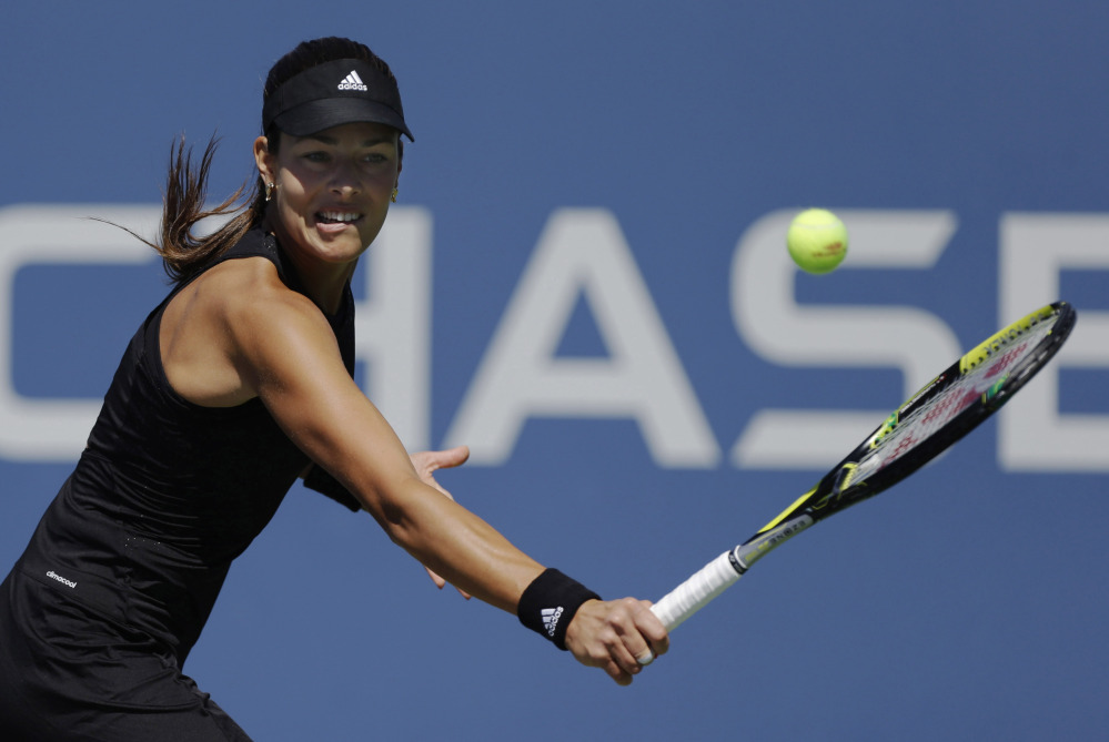 Ana Ivanovic of Serbia returns a shot against Kirolina Pliskova of the Czech Republic in Thursday's second-round match at the U.S. Open. Ivanovic, seeded eighth, was upset by Pliskova in straight sets.