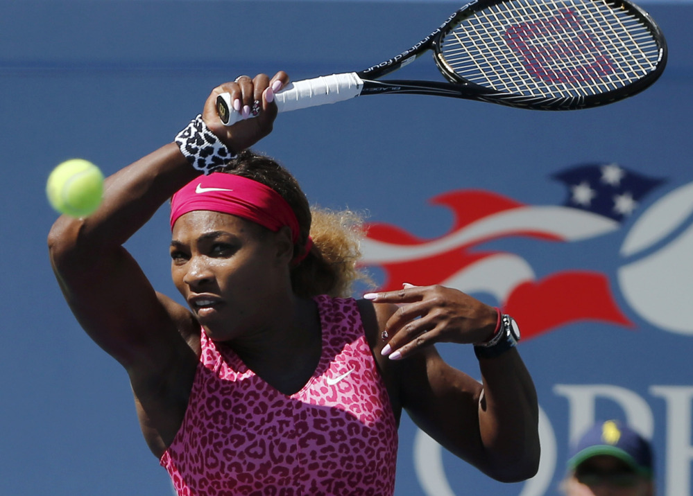 Serena Williams returns a shot to Vania King during their second-round match Thursday in New York. Williams won in just 56 minutes.